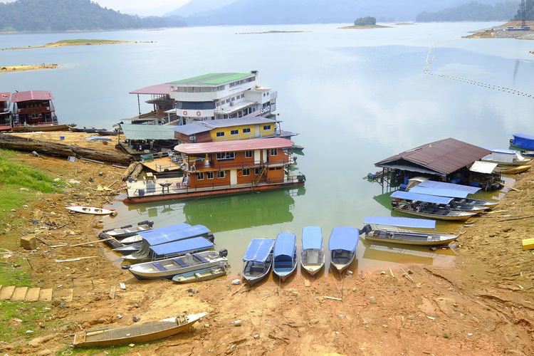 Scenic view of Kenyir lake, Malaysia in deep rainforest one of best tourism destination for nature Boats⛵️ Kenyir Lake Trolley Boat Dam Lake Day Ecotourism House House Boat Houseboat Jetty Jetty View Lake Lake View Lakeshore Lakeside Malaysia Nature No People Outdoors Tasik Kenyir Tasik Kenyir Tranquil Scene Visit Water