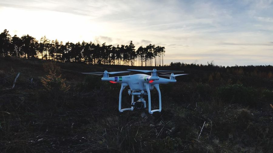 Dji Phantom Dji Dronephotography Drone  Sky Plant Cloud - Sky Tree Nature Field No People Land Transportation Travel Technology Air Vehicle Landscape Mode Of Transportation Growth Outdoors Sunset Environment Day Flying