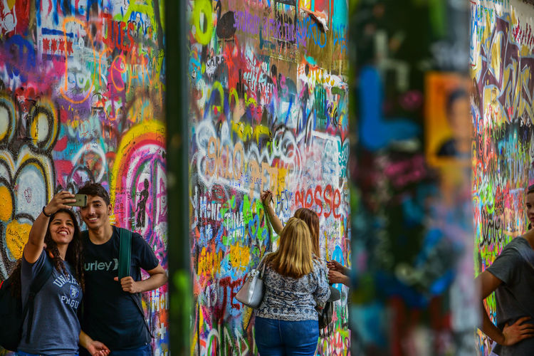 Adult Art And Craft Casual Clothing Creativity Emotion Friendship Graffiti Group Of People Happiness Leisure Activity Lifestyles Multi Colored People Real People Wall - Building Feature Women Young Adult Young Men Young Women