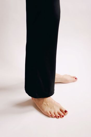 Yoga Sport Simple Simplicity Lines One Person Studio Shot Low Section barefoot Human Body Part Indoors  Women Adult Body Part Human Leg White Background Human Foot Standing Lifestyles Cut Out Females Black Color Relaxation Clothing Human Limb Nail Beautiful Woman