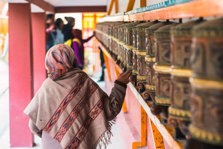The mani wheel of Buddhism... Tibet Tibetan Buddhism Buddhism Monastery Manali Himachalpradesh Himalayas One Person Lifestyles Adult Women Arrangement Order Religion Cultures India Manicure Prayer Real People Tradition Belief Life Storytelling The Art Of Street Photography The Traveler - 2019 EyeEm Awards