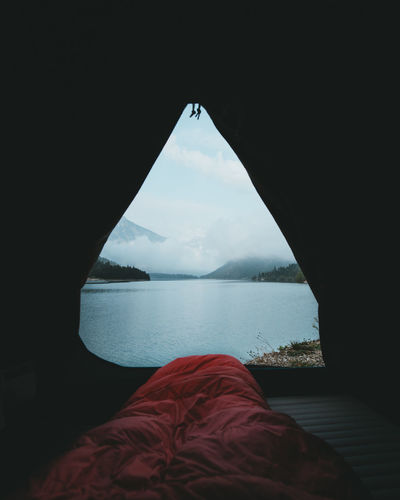 Lake against sky seen through tent