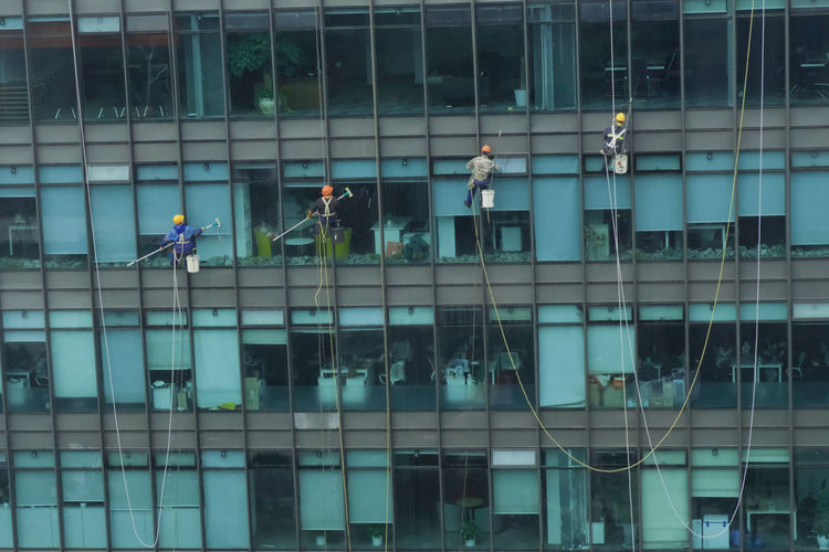 Four spiderman on the other side. Architecture Building Exterior Built Structure Cleaner Cleaning Men Outdoors Real People RISK Window Window Washer Working