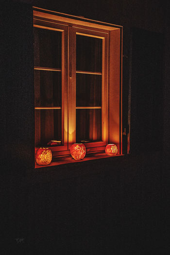 Window of illuminated house