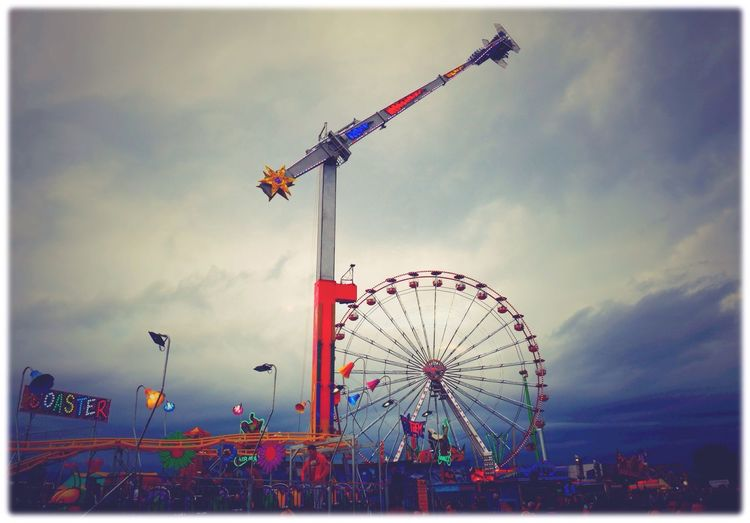 Night Lights Fairground Funfair Streetphotography Clouds And Sky Newcastle Upon Tyne Looking Up Urban Photography Hoppings Ferris Wheel