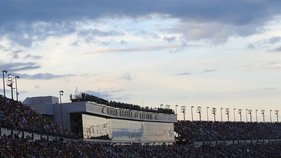 Architecture Racetrack Grandstands Suites People Fans Beautiful Sky And Clouds Daytona International Speedway At A Distance Photography