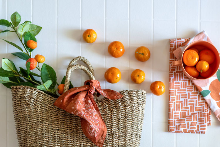 Directly above shot of orange fruits on table at home