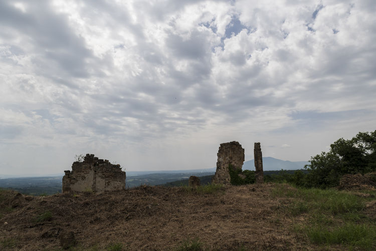 Old ruin building on landscape against sky