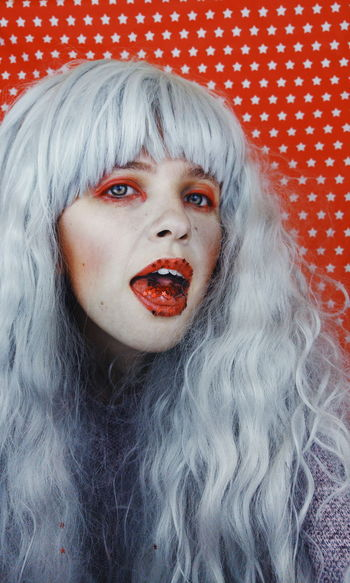 Adult Bangs Bizarre Close-up Evil Fear Hair Hairstyle Halloween Headshot Horror Human Face Indoors  Lipstick Long Hair Looking At Camera Make-up One Person Portrait Red Studio Shot