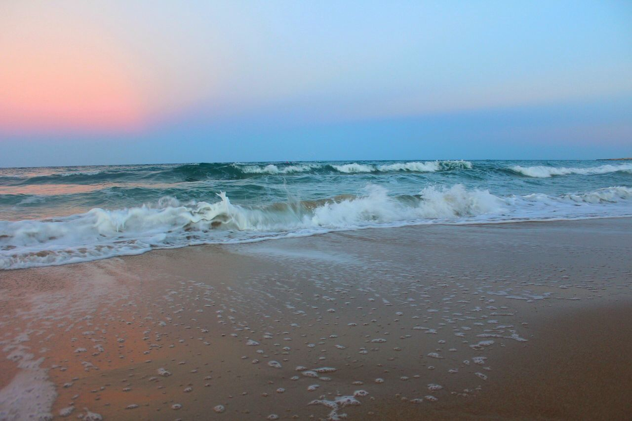 sea, beach, water, sky, horizon over water, beauty in nature, land, horizon, scenics - nature, wave, motion, aquatic sport, sand, sport, tranquility, surfing, tranquil scene, nature, outdoors