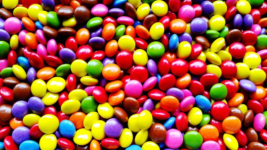 many colorful smarties Sweet Chocolate Buttons Smarties Sweets Multi Colored Candy Backgrounds Variation Full Frame Close-up