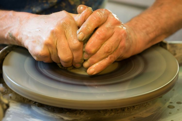 Cropped Image Of Man Making Pottery On Pottery Wheel