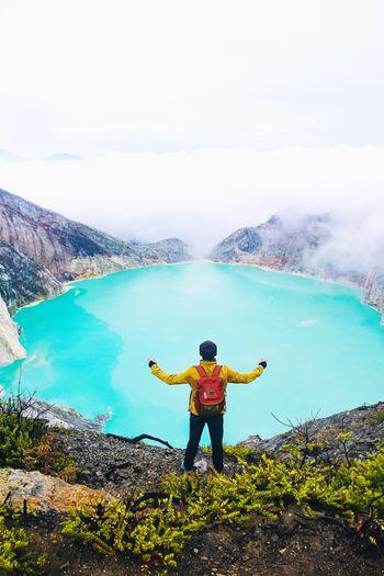 Kawah Ijen, Banyuwangi, Indonesia. INDONESIA Kawahijen #Adventure #photography #Nature  #EyeEmNewHere #landscape #nature #photography #travel #travelphotography Water Full Length Standing Men Human Arm Arms Raised Limb Sky