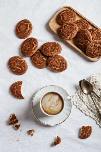 High angle view of cookies and coffee on table