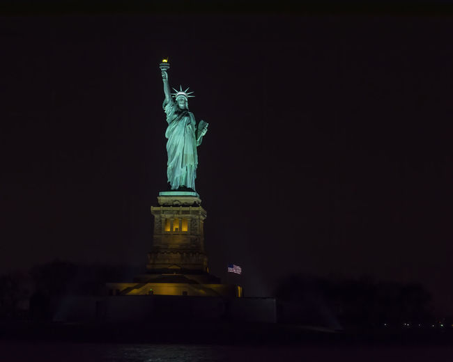 Statue of lit up at night