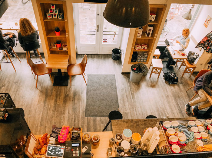 People eating at the coffee shop Indoors  Large Group Of Objects Choice Variation High Angle View Business Flooring Wood - Material Table Seat Collection No People Hardwood Floor Small Business Chair Food And Drink At The Cafe Coffee Shop