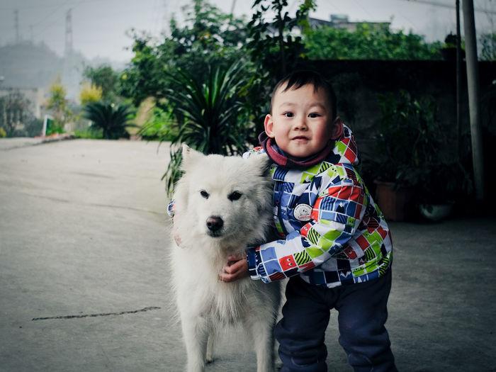 Portrait of cute boy with dog