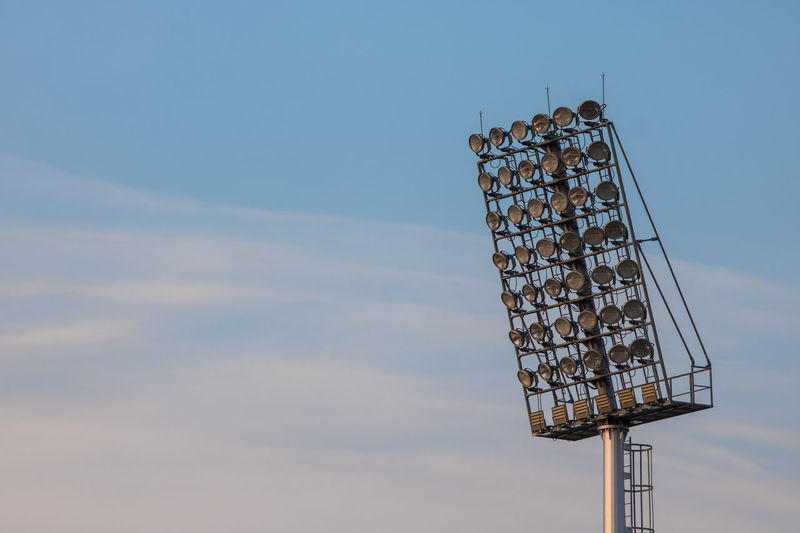 Low angle view of floodlight against sky