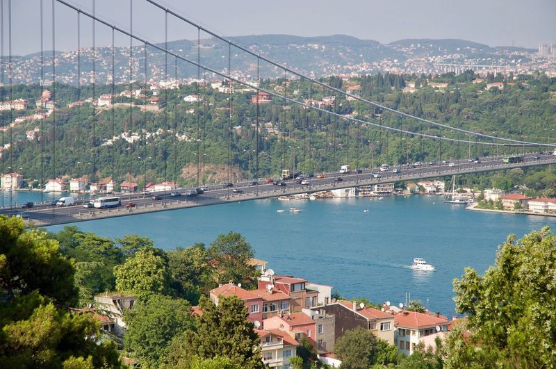 High angle view of bridge over sea and buildings