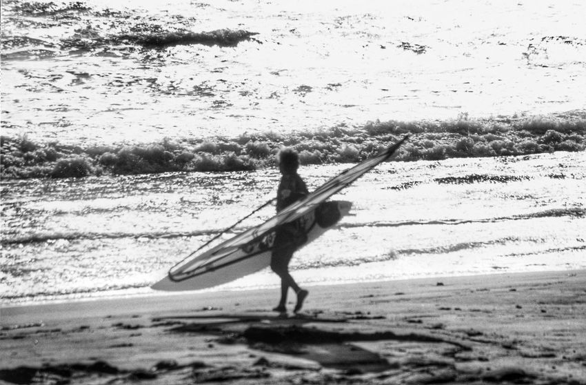 Wind surfer walking on beach Black&white Monochrome Black And White Black & White Silouette Wind Surf Wind Surfer Wind Surfing Windsurfer America California Oceanside Surfer Surf Editorial  Surfers Blackandwhite Black & White Photography Black And White Photography Surf Photography Surfer Dude Ocean Beach Taking Pictures Travel Photography
