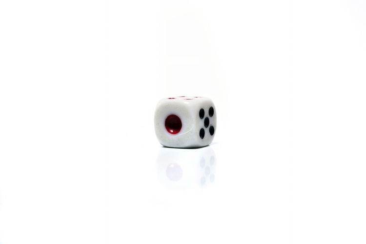 Rolling White dice isolated on white background Arts Culture And Entertainment Close-up Copy Space Creativity Cut Out Dice Directly Above Fun Gambling Indoors  No People Positive Emotion Red Simplicity Single Object Smiling Studio Shot Technology White Background White Color
