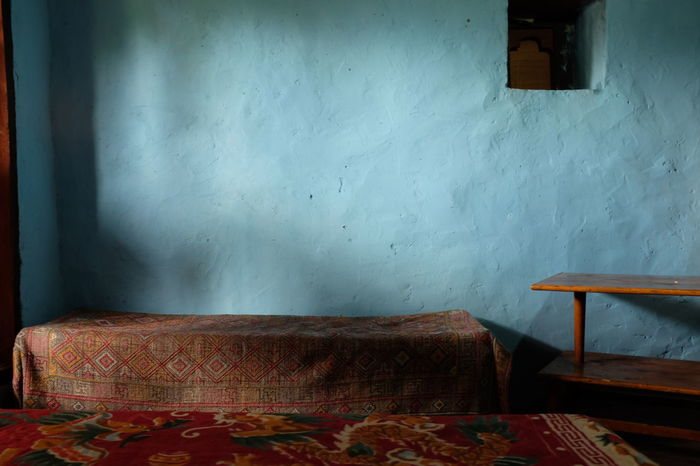 bhutan mornings have the best light Bhutan Bhutanese Architecture Blue Color Blue Sky Copy Space Getting Inspired Himalayas Indoors  Minimal Minimalism Minimalist Minimalobsession Morning Light No People Old Tave Pastel Pastel Blue Rustic Seating Area Soft Light Spartan Atmoshpere