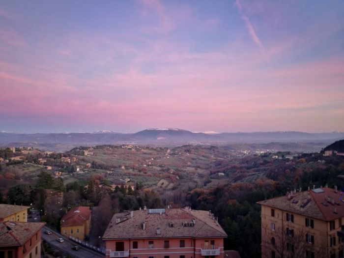 Umbria in a shot Snow Perugia Historic City EyeEm Selects No People Mountain Tree Outdoors Red Sky Sunset City Landscape Nature Architecture Cityscape Day