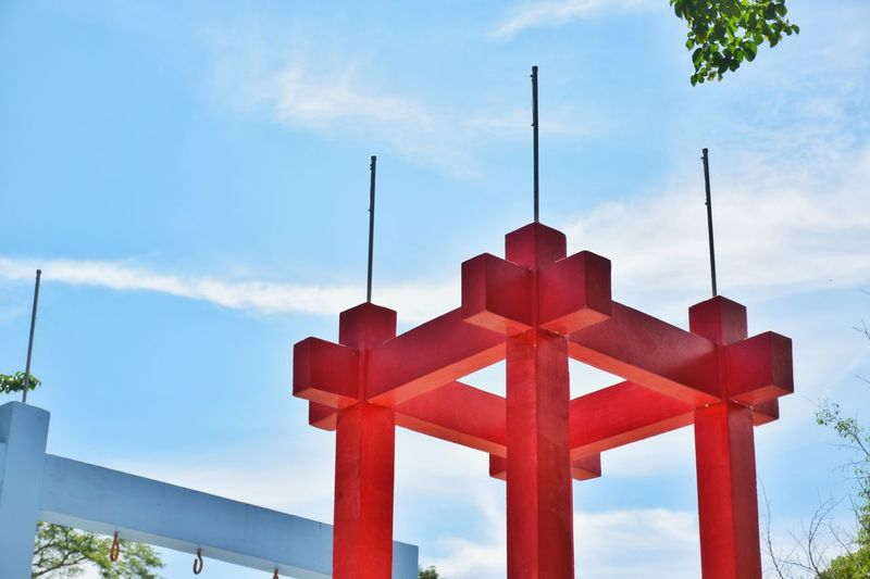 Architecture Belief Blue Built Structure Cloud - Sky Cross Cross Shape Day Focus On Foreground Low Angle View Metal Nature No People Outdoors Red Religion Sky Spirituality Wood - Material