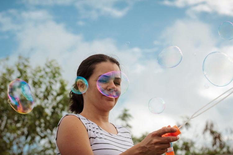 Portrait of woman  making bubbles