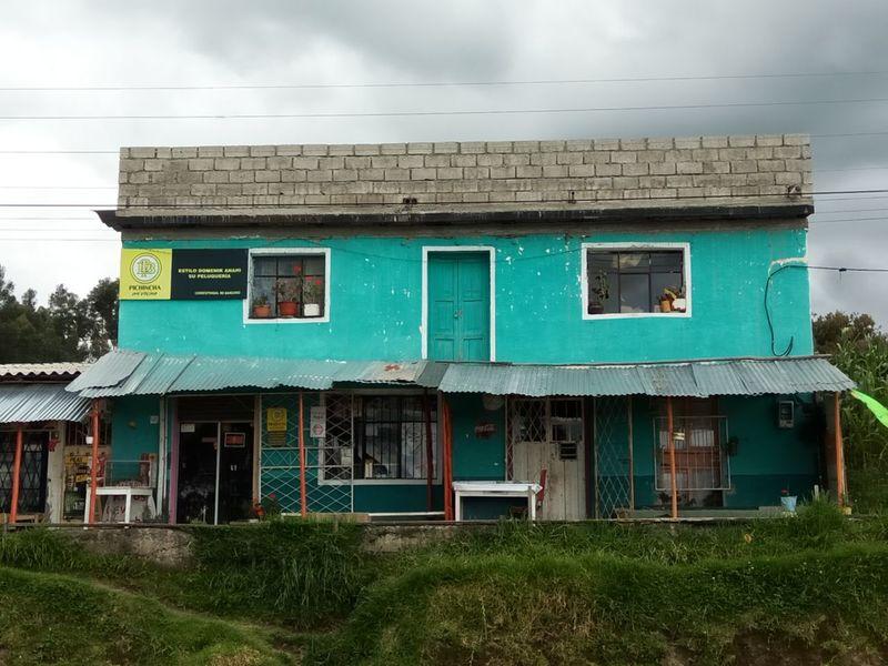 Architecture Building Exterior Built Structure Cloud - Sky Day Ecuador Grass Green Color Local Shops No People Outdoors Sky Solar Panel