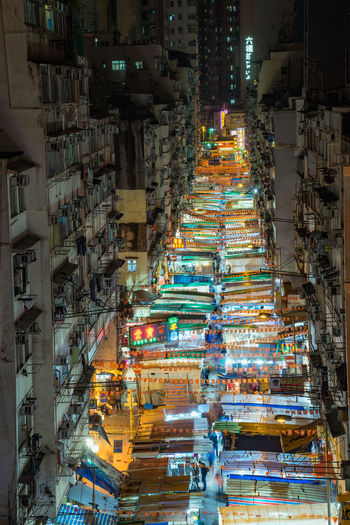 High Angle View Of Illuminated Night Market Amidst Buildings In City