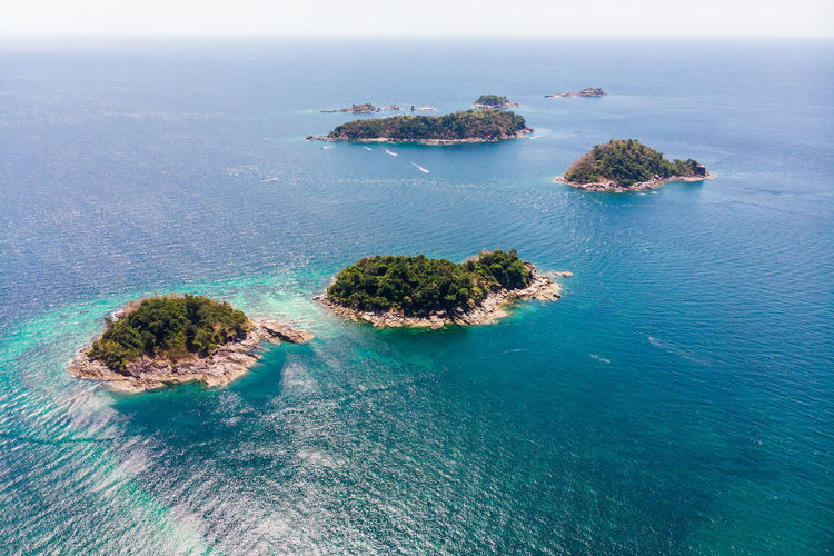 Aerial view of archipelago in tropical sea at lipe island Water Sea Scenics - Nature Beauty In Nature Tranquility Tranquil Scene High Angle View Land Nature Blue Horizon No People Day Idyllic Horizon Over Water Sky Rock Outdoors Beach Turquoise Colored Yacht Stack Rock
