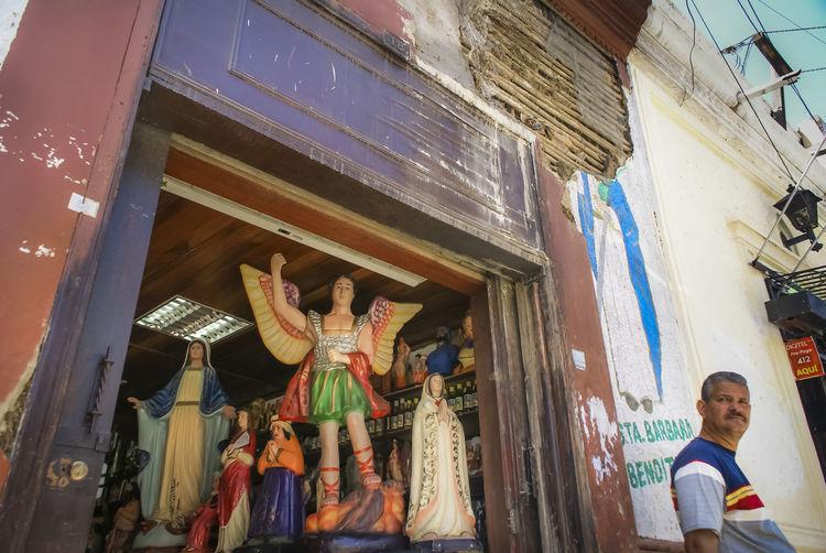Saints shop in a Venezuelan town Caribbean Life Catholic Cumaná Venezuela Architecture Belief Caribbean Religion Representation Saints Storefront Town