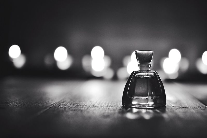 Perfume on table at home