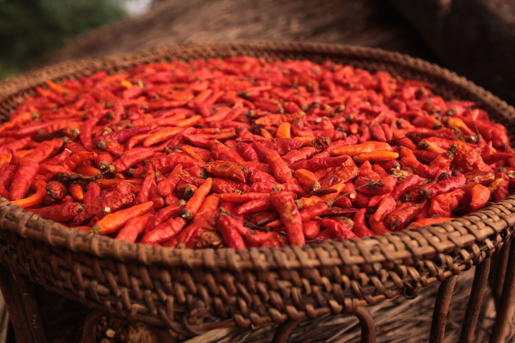 High Angle View Of Red Chili Peppers In Container