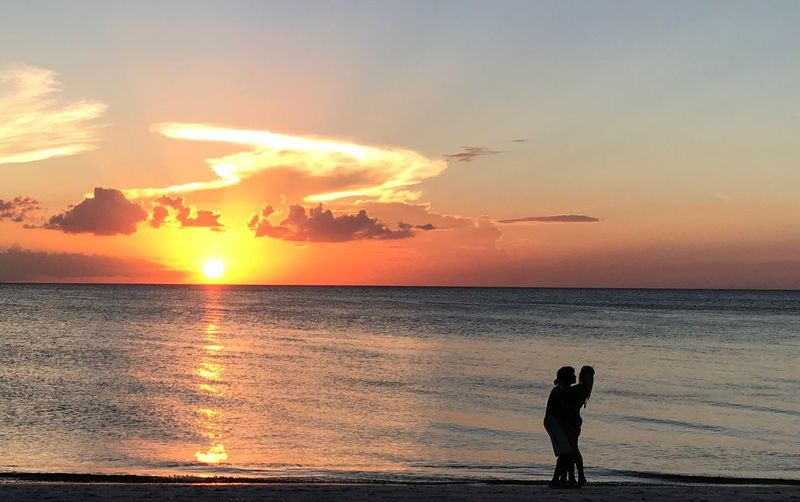 Sunset Sky Water Sea Beach Land Beauty In Nature Orange Color Horizon Over Water Scenics - Nature Horizon Real People Cloud - Sky Silhouette Nature Outdoors Tranquility Sun