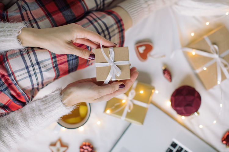 High angle view of hand holding christmas decoration