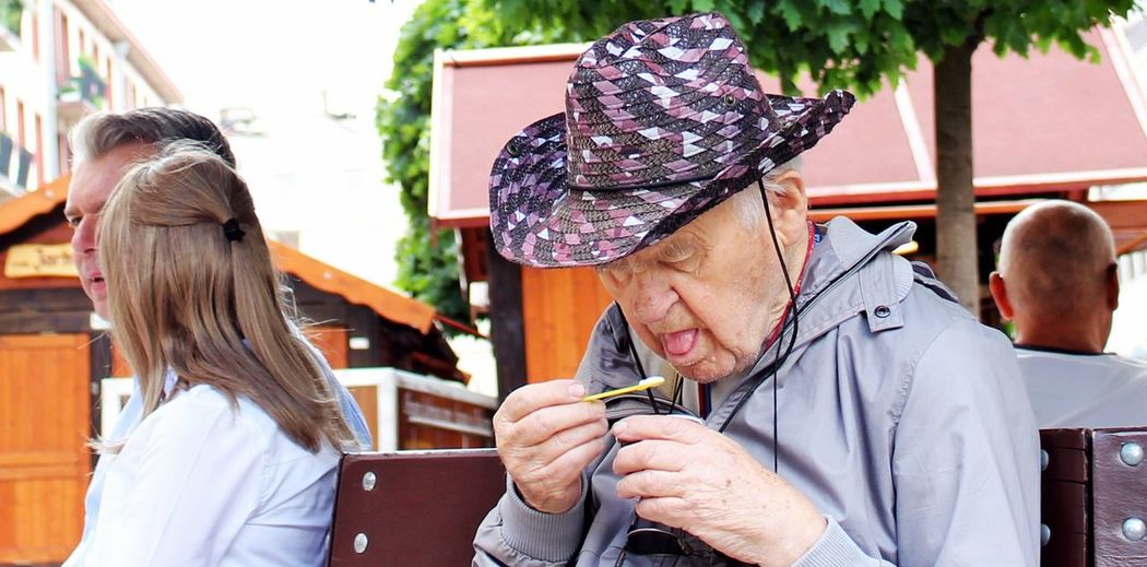 Ice cream tastes of all ages Bench Hat Lick Sit Adult Ice Cream People Real People Senior Adult Summer