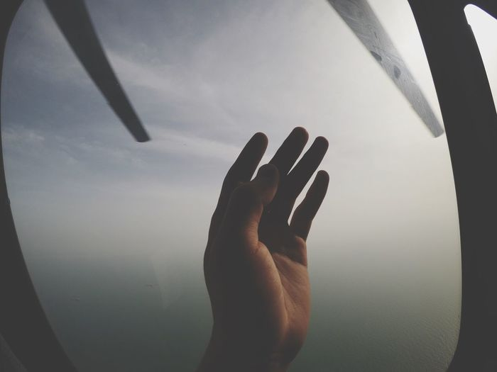Fly with helicopter Sky Sea Helicopter Human Hand Hand Real People Human Body Part One Person Close-up Body Part Day Window Lifestyles Leisure Activity Unrecognizable Person Personal Perspective Human Finger