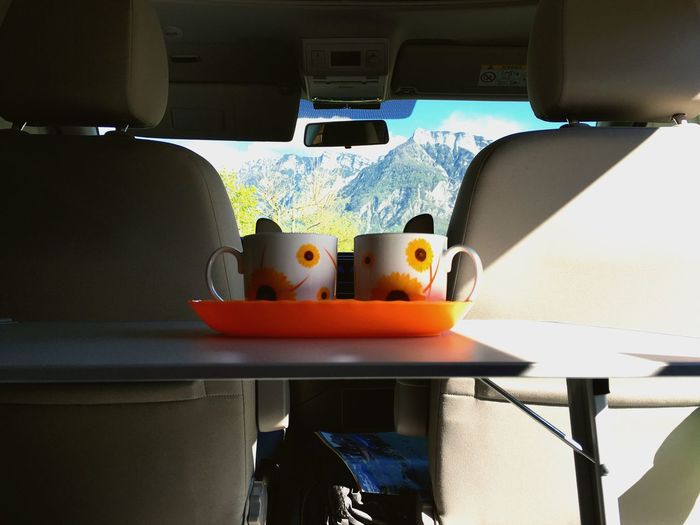 Vehicle Interior Transportation No People Vehicle Seat Car Interior Day Indoors  Close-up Mountain Van Camping Traveling Let's Go. Together. Cup Summer Couple