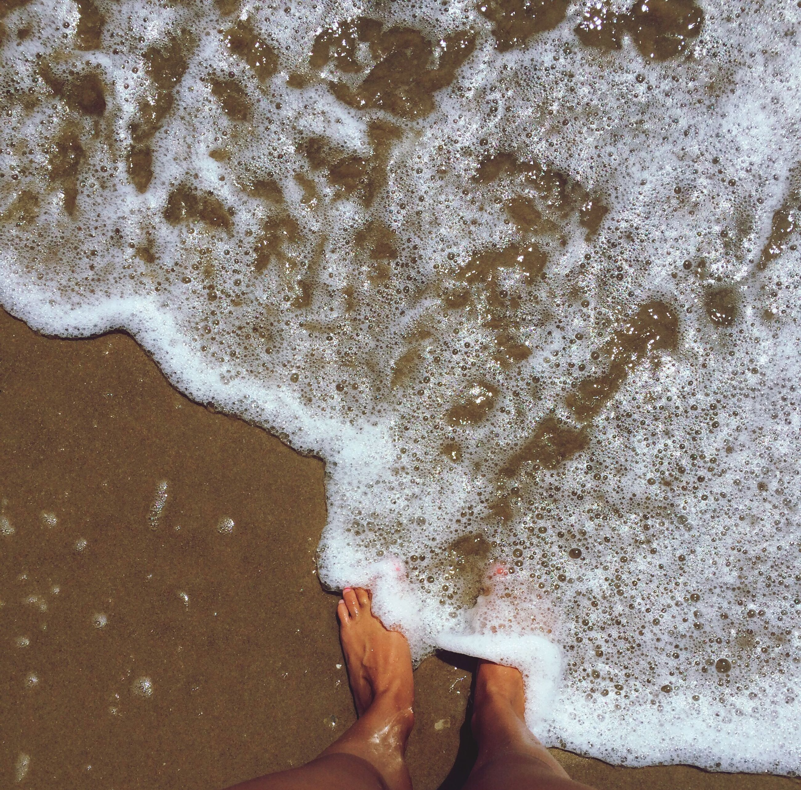 water, beach, surf, low section, person, sea, personal perspective, shore, sand, barefoot, wave, human foot, high angle view, motion, lifestyles, leisure activity, wet