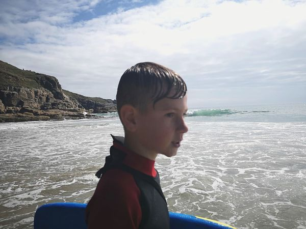 fun in the sea. Cornwall is such an awesome place to live. Body Boarding Beach Fun Cornwall Uk EyeEm Selects Eye Em Portraits Cornish Life Boy In A Wetsuit Activities Water Child Sea Childhood Beach Boys Headshot Males  Standing Side View Surfing Wetsuit Water Sport