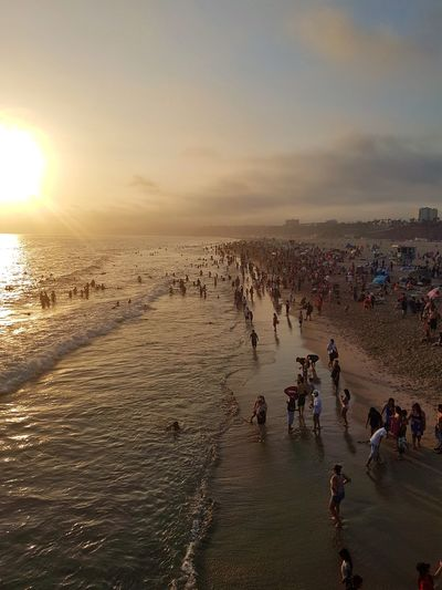 Beach! Santa Monica July 2017 Santa Monica Santa Monica Pier July 2017 America Summer Vacation Tourist Attraction  Sunset Over Water Water Sunset Beach Crowd Men Sand Sea Sky Ocean Wave Coast Surf Tide