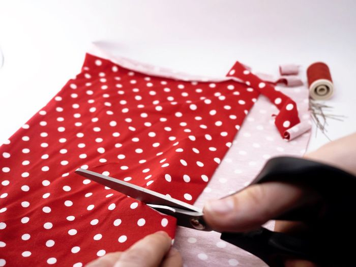 Sewing Working Hands Art And Craft Cutting Scissors Fabric Polka Dot Workingplace Human Hand Human Body Part One Person Red Holding Indoors  One Woman Only Women Close-up