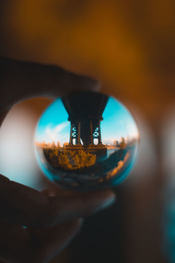 New York Teal And Orange Under The Bridge Close-up Human Hand Lens Ball Outdoors Perspective Photography