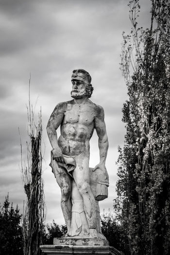 Human Statue Against Sky At Park