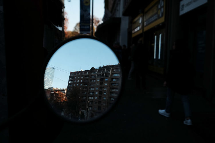 Reflection of man in city