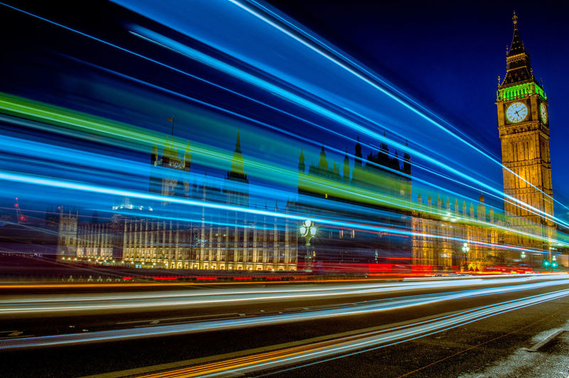 Low angle view of light trails in city at night