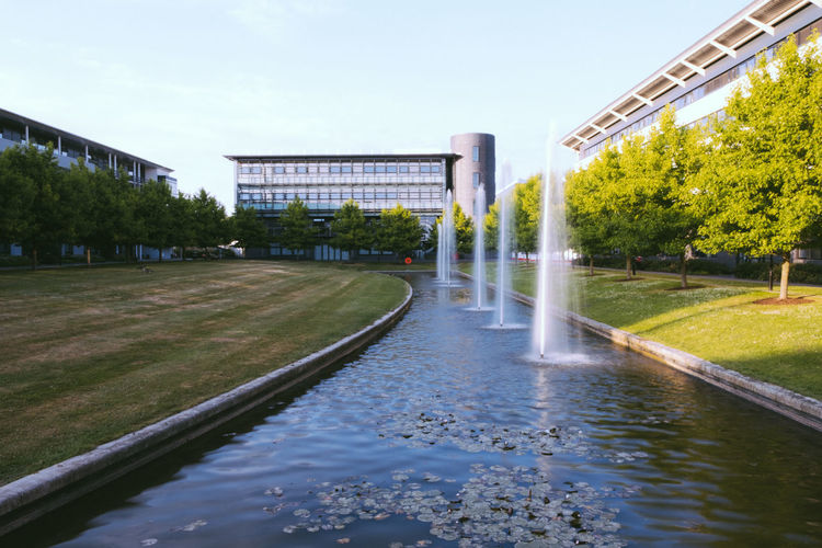 Achitecture Campus Trees Building Exterior Built Structure Flowing Water Grass Outdoors Plant Sunset Water