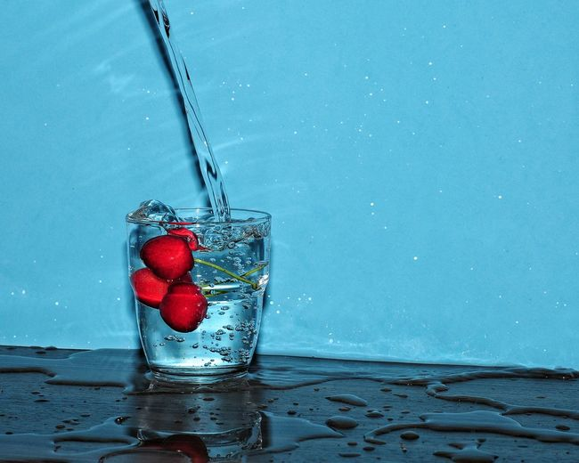 Close-up of red berries in water